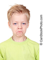 Offense - Cute little boy looking at camera with offended...