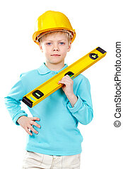 Little constructor - Cute boy in hardhat holding a level and...