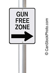 Gun Free Zone - Modified one way sign indicating gun free...