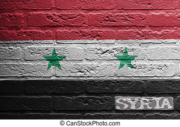 Brick wall with a painting of a flag, Syria - Brick wall...