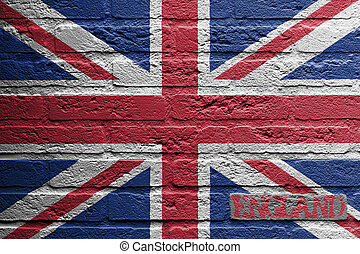 Brick wall with a painting of a flag isolated, UK