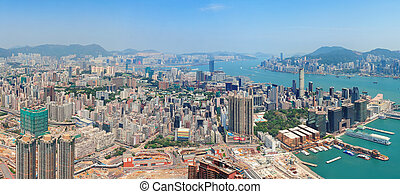 Hong Kong aerial view panorama with urban skyscrapers boat...