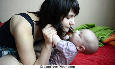 Young mother playing and kissing