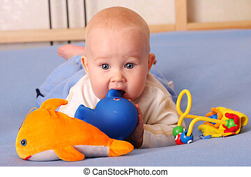 Baby plays with toys 2 - The beautiful happy baby plays with...