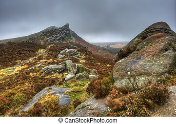 Ramshaw Rocks in Peak District National Park on foggy Autumn...
