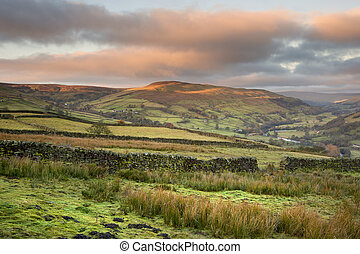 Swaledale in Yorkshire Dales National Park at sunrise with...