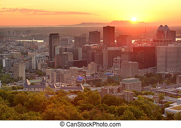 Montreal sunrise silhouette viewed from Mont Royal with city...