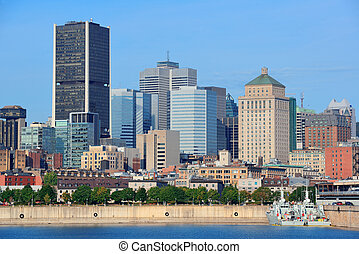 Montreal city skyline over river in the day with urban...
