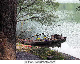 Waiting-Noon - A boat is waiting for a journey in a lake of...