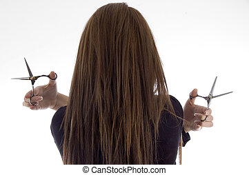 back pose of female with scissors with white background