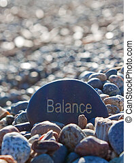 rock written with word balance. - a stone written with the...