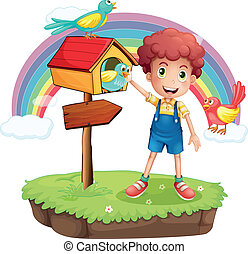A young boy and the wooden pethouse and signboard
