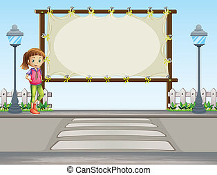 A girl standing near an empty signage