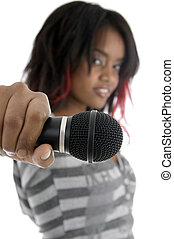 young girl showing microphone on an isolated white...