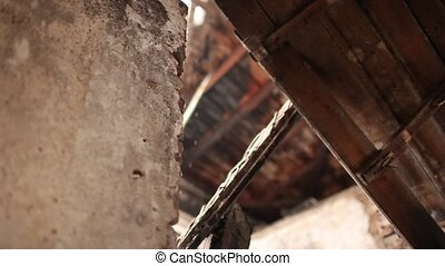 old barn - inside view damaged wooden roof of an old barn