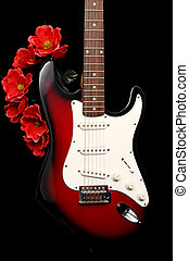 electric guitar and fake red flowers, black background