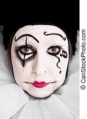 portrait of an sad female clown - portrait of an sorrowful...
