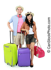 Happy young couple going on vacation - portrait of happy...