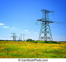 high voltage power line in the field - high voltage...