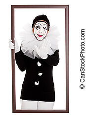 funny clown in a frame stretches out hand - female clown in...