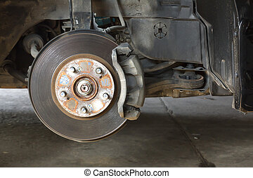 Front disk brake on car in process of damaged tyre...