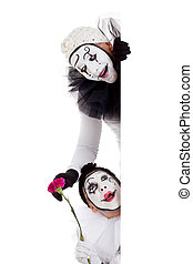 two clowns in love looking around a border - two clowns in...