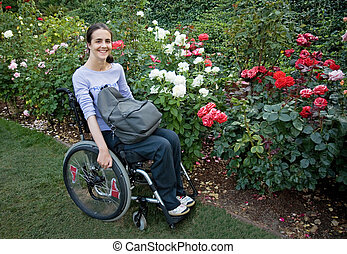 Blooming - Beautiful young woman in a wheelchair visiting a...