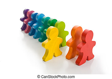 Stand Out - Line of colorful wooden people - one yellow...