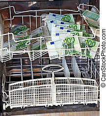 Washing money - clean new hundred euro banknotes in...