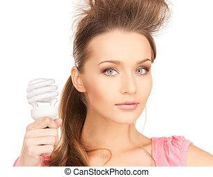 woman with energy saving bulb