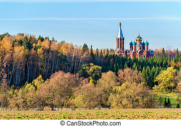 Church in autumn forest - Russian landscape with church in...