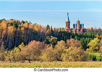 Church in autumn forest