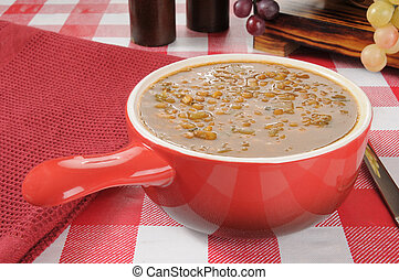 Lentil Soup - A stoneware serving dish of lentil soup