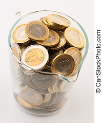 glass jar full of coins of one and two euro