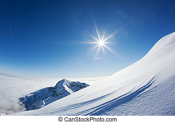 Snowy mountain landscape in a winter clear day. Western...