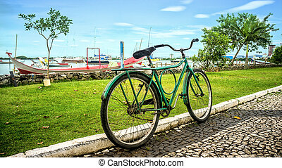 Old and rustic bike at seaside