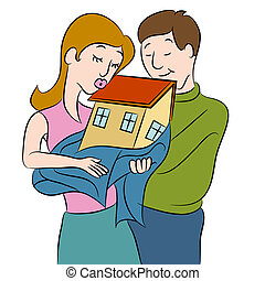 New Homeowners - An image of a couple holding their new home...