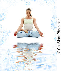 padmasana lotus pose on white sand - sporty girl practicing...