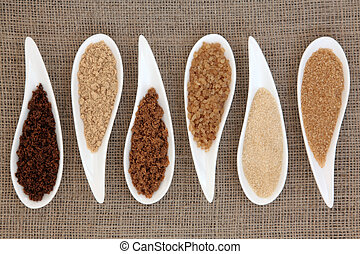 Sugar Types - Sugar varieties in white dishes over hessian...