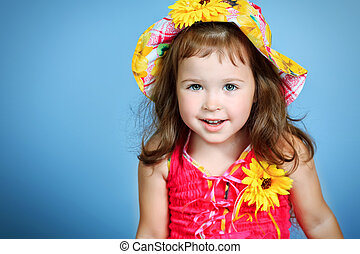 sincere - Pretty little girl in a floral hat and dress over...