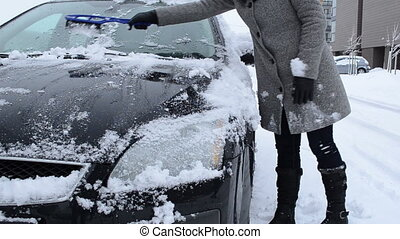 snow car woman sledge - woman clean remove snow from car in...