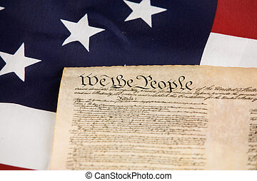 We The People - US Constitution against an american flag