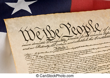 We The People - US Constitution against an american flag.