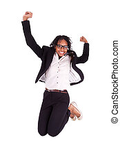 Young african american business woman jumping, success...