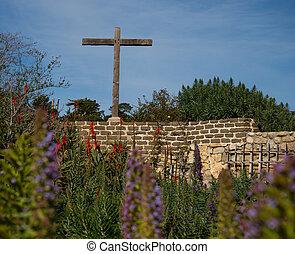 Cross in Carmel Mission garden - Holy Cross in the...