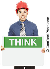 Think Sign - A man wearing a hardhat and holding a blank...