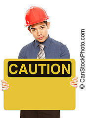 Blank Caution Sign - A man wearing a hardhat and holding a...