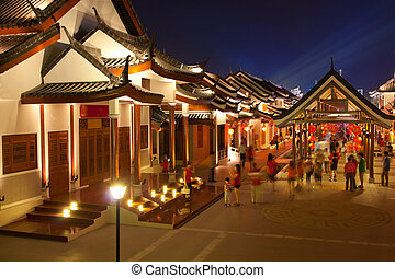 chinese ancient town - crowd walking in chinese ancient town...