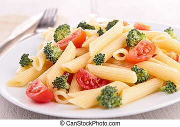 plate of pasta with tomato and broccoli