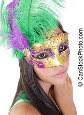 Beautiful young woman in carnival mask. Isolated on white background.
